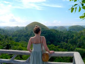 Standing in front of the Chocolate Hills